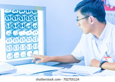 Doctor Looking at X-Ray Radiography in patient's Room