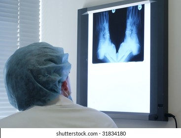 Doctor looking the x-ray shot