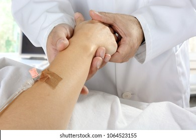 Doctor looks after sick patient at bedside or deathbed in hospital or clinic