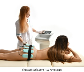 Doctor make anti-cellulite anti-fat therapy massage for woman on  buttocks in beauty salon. Body care. Ultrasound deep cavitation body contouring spa and  wellness treatment healthcare
