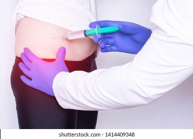 The doctor makes an injection of hyaluronic acid and chondroprotector with anesthesia in the hip joint of the girl, the treatment of arthritis, medical, osteoarthritis