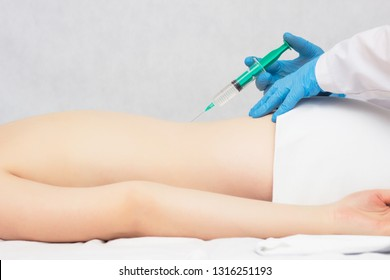 The doctor makes an injection of ozone and chondroprotector in the spine to the patient, ozone therapy, inflammation