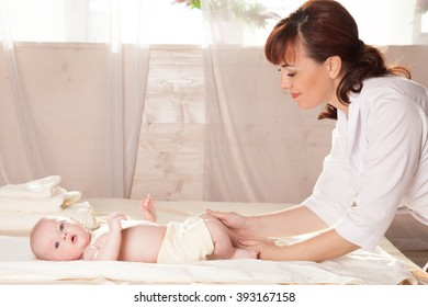 doctor makes small baby kid massage healthy