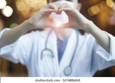 Doctor making heart shape.Medicine, people, charity, health care and cardiology concept