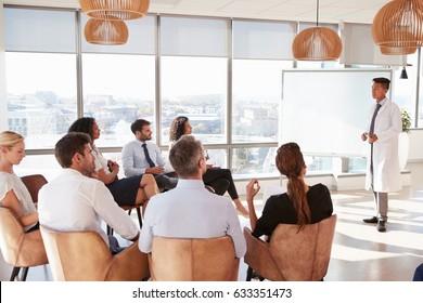Doctor Making Presentation To Medical Staff In Hospital