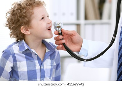 Doctor male examining a child by stethoscope