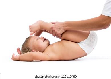 doctor massaging or doing gymnastics baby girl