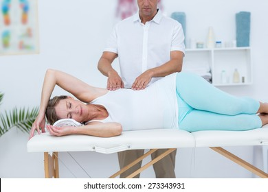 Doctor massaging his patient in medical office