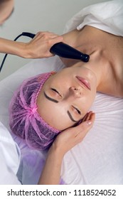 doctor masseur doing biomechanical stimulation special black appliance wand