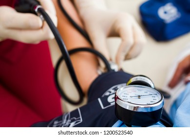 The doctor measures the pressure with a tonometer. Tonometer closeup