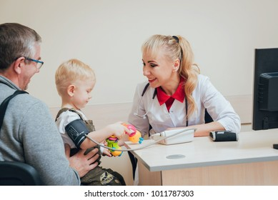 Doctor measuring blood pressure of a child. Medical equipment