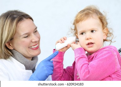 A Doctor measuring with Infrared Thermomete temperature  a Child