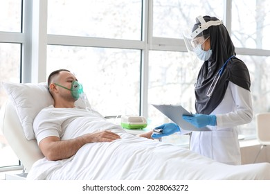 Doctor measuring oxygen saturation level of patient blood in clinic