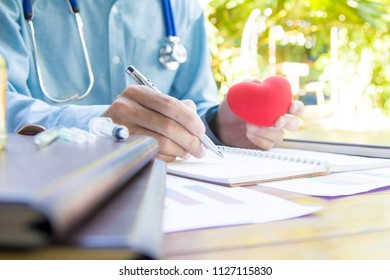 The doctor is measuring pressure and diagnosing patients with heart disease.