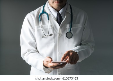 Doctor or medic using smartphone.