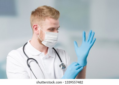 doctor with medical face mask and stethoscope puts on his medical gloves