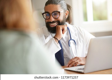 Doctor in medical office having an appointment with a patient