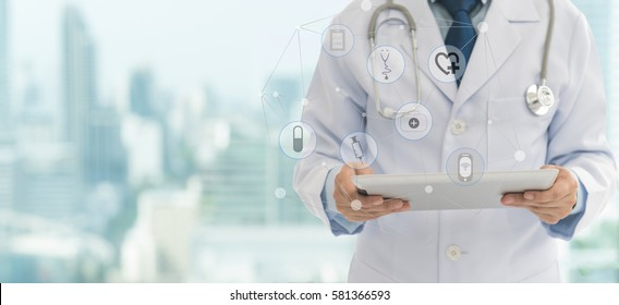Doctor or medical students using digital tablet with medical icon at hospital. Medical technology network concept. copy space.