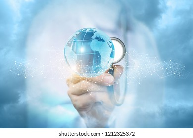 A doctor in the medical uniform is carefully touching a bright global map with a stethoscope behind a slight chain of tiny wireless connections . The concept of global health care.