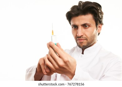Doctor in medical uniform with syringe and medicine ready to make injection, closeup portrait