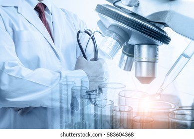 Doctor with microscope, medical research and development concept