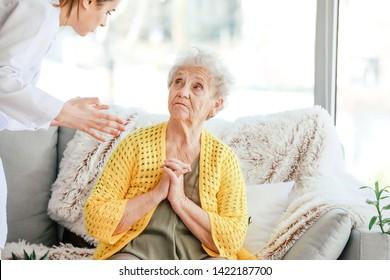 Doctor mistreating senior woman in nursing home