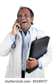 Doctor with mobile phone laughing