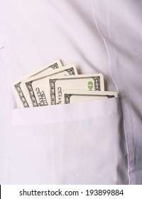 doctor with money in his pocket