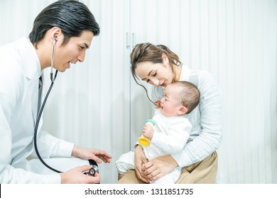 Doctor and mother and child in a consultation room. Pediatrician.