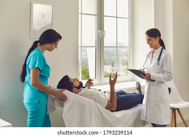 A doctor and a nurse advise a patient after an examination in the clinic office. Medical assistance in the hospital.