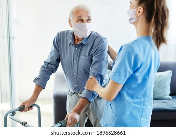 Doctor or nurse caregiver with senior man wearing protective maks and using walker assistanece  at home or nursing home