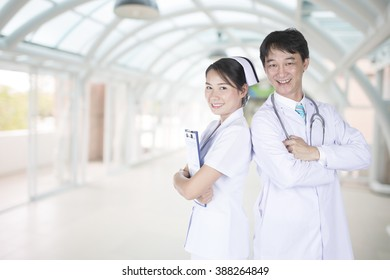 Doctor and nurse with a commitment in the hospital.