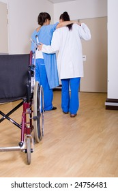 doctor or nurse helping her patient to walk without wheelchair