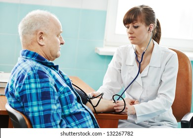 doctor nurse measuring blood pressure of patient by phonendoscope in clinic hospital