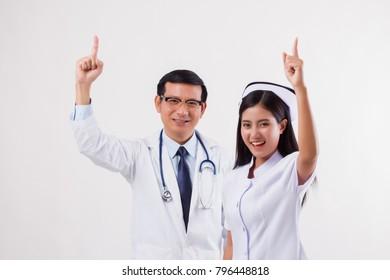 doctor and nurse, medical team giving number 1 finger gesture