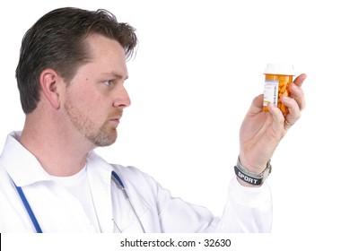 Doctor / Nurse Reading Drug Bottle