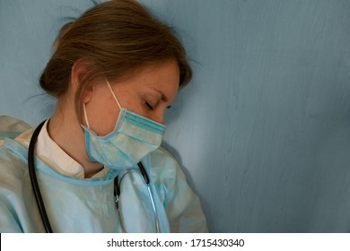 Doctor or nurse sleep. Coronavirus COVID-19 pandemic. Tired, exhausted woman in uniform is sleeping in hospital or clinic after hard duty. Female with stethoscope around neck and closed eyes