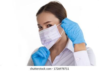 Doctor or nurse take off face mask