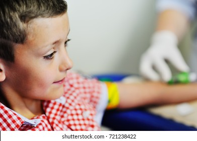 a doctor or nurse takes blood from a vein in a child of a boy. Blood chemistry
