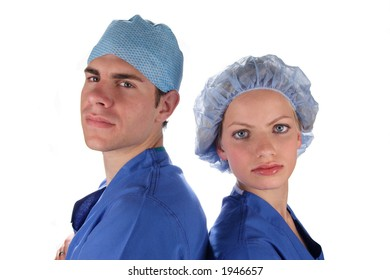 Doctor and nurse wearing surgical scrubs facing outward from each other.