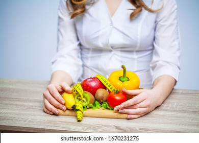Doctor Nutritionist holding fresh fruits and vegetables for a healthy diet