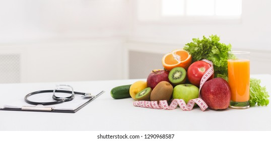 Doctor nutritionist's workplace with healthy organic food and stethoscope, panorama, copy space