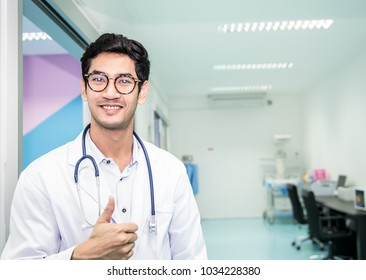 Doctor or obstetrician in grown uniform showing thump up and holding stethoscope auscultation at hospital,Doctor holding a stethoscope,Concept doctor, Patient, Medical Labor room