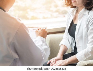 Doctor (obstetrician, gynecologist or psychiatrist) consulting and diagnostic examining female patient's on womanâ obstetric-gynecological health in medical clinic or hospital healthcare service
