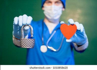 Doctor offers open padlock and red heart. Secure Medicine. Security Medical Hospital Healthcare Support.