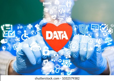 Doctor offers red heart with data text icon on a virtual interface. Big Data Medicine Modern Health Cre Information Technology concept. Smart Heart Bigdata CardiologyTech.