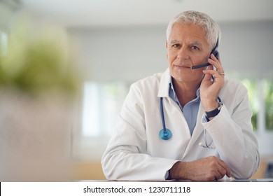 Doctor in office using headset