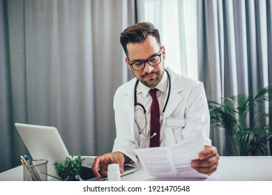 Doctor in office working on laptop. Health care concept.