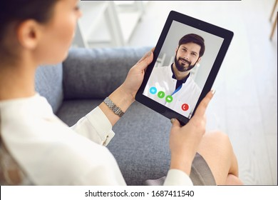Doctor online. Doctor speaks with a young woman a patient remotely.