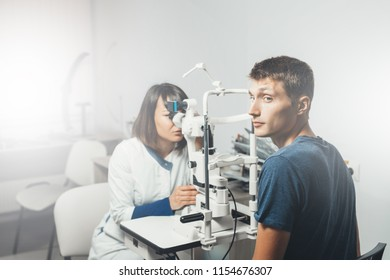 Doctor ophthalmologist checks  vision of man in clinic